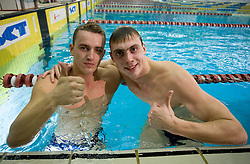 Second placed Alexei Puninski of Croatia and winner Sergey Fesikov of Russia after they competed in the 50m Freestyle at the swimming competition Ilirija Challenge 2009, on December 16, 2009, in Tivoli pool, Ljubljana, Slovenia. (Photo by Vid Ponikvar / Sportida)
