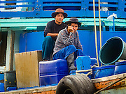 01 OCTOBER 2015 - MAHACHAI, SAMUT SAKHON, THAILAND: Fishing crewmen on a Thai fishing trawler in Mahachai, one of Thailand's largest fishing ports. Thailand's fishing industry had been facing an October deadline from the European Union to address issues related to overfishing and labor practices. Failure to adequately address the issues could have resulted in a ban on Thai exports to the EU. In September Thai officials announced that they had secured an extension of the deadline. Officials did not say how much extra time they had to meet the EU goals. Thailand's overall annual exports to the EU are between 23.2 billion Thai Baht and 30 billion Thai Baht (US$645 million to US $841 million). Thailand's total fish exports were worth about 110 billion baht in 2014.    PHOTO BY JACK KURTZ