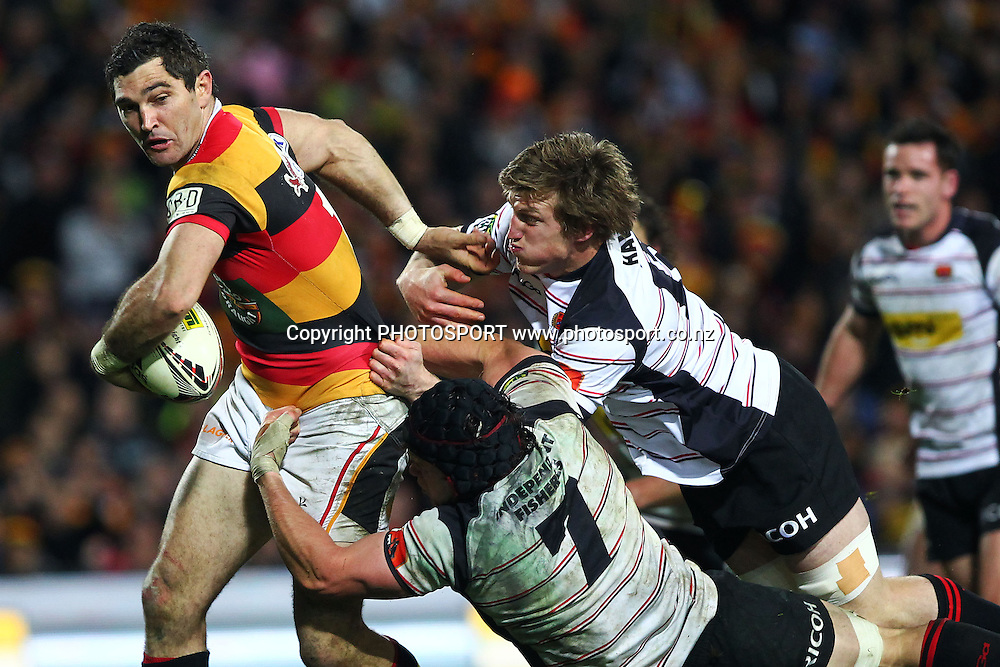 Waikato's Stephen Donald is tackled by Canterburys' Matt Todd. ITM Cup Final, Waikato v Canterbury at Waikato Stadium, Hamilton, New Zealand. Saturday 3rd September 2011. Photo: Anthony Au-Yeung / photosport.co.nz