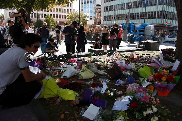 Flowers and cards are placed on Cathedral Square to honour the earthquake victims