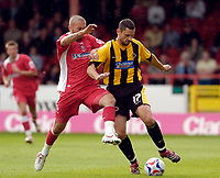 Photo: Leigh Quinnell.<br /> Swindon Town v Boston United. Coca Cola League 2. 30/09/2006. Bostons Stewart Talbot is challenged by Swindons Christian Roberts.
