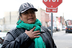 Local resident and SNBL's president<br /> Gloria Cartagena, stands on the jasper Street and Somerset corner in the Kensington section of Philadelphia, PA, on March 25, 2018. (Bastiaan Slabbers for WHYY)