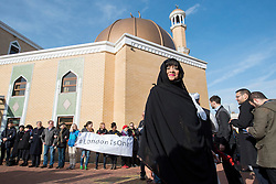 "© Licensed to London News Pictures. 03/02/2017. London, UK.  Bibi Rabbiyah Khan, from the London Islamic Cultural Society, stands in front of a human circle of solidarity forming outside Wightman Road mosque in north London during Friday prayers in an event backed by a coalition of faith groups, including members of Reform Judaism, the Christian Muslim Forum and Faiths Forum for London.  The aim is to ""stand with our Muslim brothers and sisters at this time of international turbulence"", say the organisers. Photo credit : Stephen Chung/LNP"