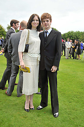 SOPHIE ELLIS-BEXTOR and RICHARD JONES at the 3rd day of the 2009 Glorious Goodwood racing festival held at Goodwood Racecourse, West Sussex on 30th July 2009.