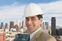 Man wearing hard hat in city
