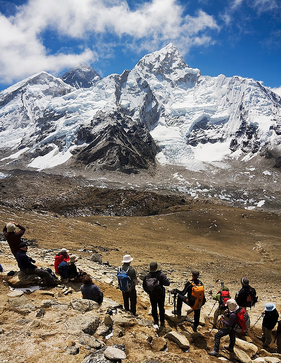 A Jagged Globe trekking group admires the views of Mount Everest (8848m) and Nuptse (7861m) from Kala Patthar (5545m), for many the final destination on the Everest Base Camp Trek, Khumbu region, Sagarmatha National Park, Himalaya Mountains, Nepal.