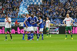 05.10.2013, Veltins Arena, Gelsenkirchen, GER, 1. FBL, Schalke 04 vs FC Augsburg, 8. Runde, im Bild Schalker Torjubelrudel waehrend v.l.n.r. Sascha Moelders, Paul Verhaegh und Kevin Vogt ( alle FC Augsburg Freisteller/ Emotion ) enttaeuscht sind. // during the German Bundesliga 8th round match between Schalke 04 and FC Augsburg at the Veltins Arena, Gelsenkirchen, Germany on 2013/10/05. EXPA Pictures © 2013, PhotoCredit: EXPA/ Eibner/ Thomas Thienel<br /> <br /> ***** ATTENTION - OUT OF GER *****