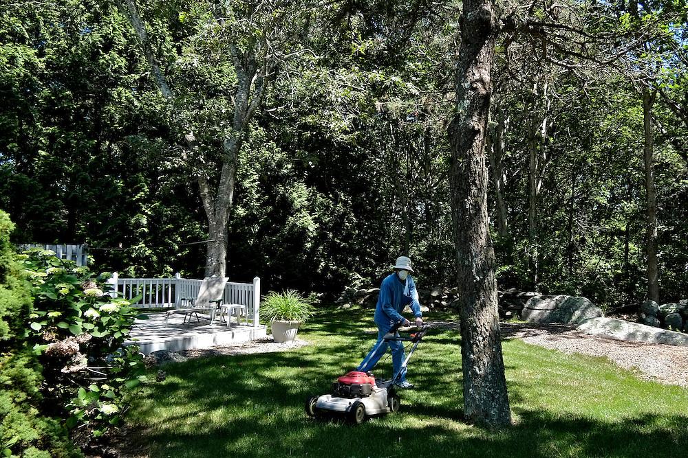 Leonard mowing the lawn. Wakefield, RI