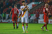 Bradford City defender Nat Knight-Percival (22) applauds the fans at the end during the EFL Sky Bet League 1 match between Walsall and Bradford City at the Banks's Stadium, Walsall, England on 17 December 2016. Photo by Simon Davies.
