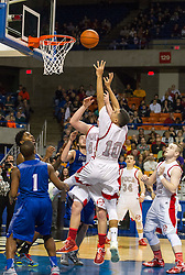 Poca forward Elijah Cuffee (10) puts a shot back up in the lane against Fairmont Senior during the Class AA championship game at the Charleston Civic Center.