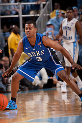 CHAPEL HILL, NC - MARCH 05: Tyler Thornton #3 of the Duke Blue Devils defends while playing the North Carolina Tar Heels on March 05, 2011 at the Dean E. Smith Center in Chapel Hill, North Carolina. North Carolina won 67-81. (Photo by Peyton Williams/UNC/Getty Images) *** Local Caption *** Tyler Thornton