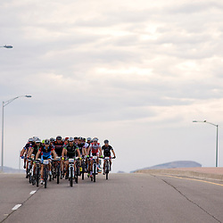 The pro men ride the pavement as the sun rises over Grand Junction, Colorado.<br /> Photos by Brian Leddy