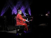 Elton John performing, M.A.C. Aids fund benefit concert given by Elton John. Shepherds Bush Empire. 16 December 2002.<br />© Copyright Photograph by Dafydd Jones 66 Stockwell Park Rd. London SW9 0DA Tel 020 7733 0108 www.dafjones.com
