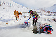 With no running water in the winters, washing clothes in Spiti involves digging a hole in a thick sheet of ice to expose the flowing stream under it. It is a weekly job of the hardworking Spitian to wash clothes even in sub zero temp.