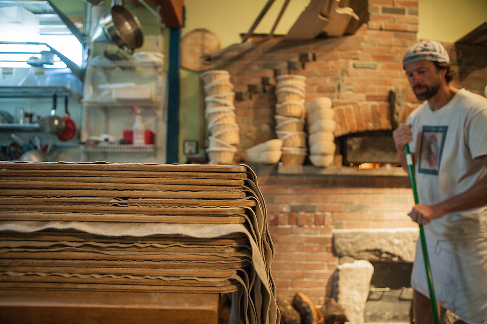 Jamestown, RI - 7 May 2007. Andrea Colognese, baker and co-owner of The Village Hearth Bakery and Cafe, cleaning up at the end of the baking.