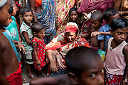 A widow, Rubi Begum, 40 (sitting in center), sells her products in Ghagoa Villlage, Gobindagonj Upazila, Gaibandha, Bangladesh on 19th September 2011. Living alone after her husband's passing, she has now (since 2.5 years) found financial independence by working as a saleswoman, earning 3500 - 5000 Bangladeshi Taka per month. She is one of many rural Bangladeshi women trained by NGO CARE Bangladesh as part of their project on empowering women in this traditionally patriarchal society. Named 'Aparajitas', which means 'women who never accept defeat', these women are trained to sell products in their villages and others around them from door-to-door, bringing global products from brands such as BATA, Unilever and GDFL to the most remote of villages, and bringing social and financial empowerment to themselves.  Photo by Suzanne Lee for The Guardian