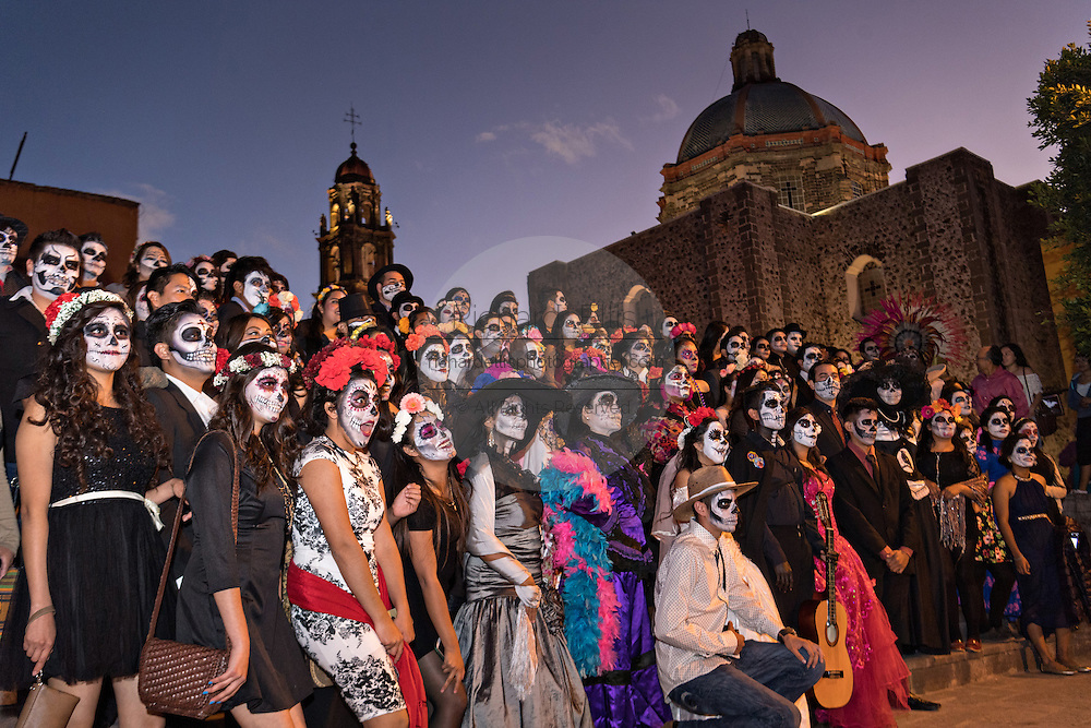 Students dressed as La Calavera Catrina pose together during the Day of the Dead festival October 28, 2016 in San Miguel de Allende, Guanajuato, Mexico. The week-long celebration is a time when Mexicans welcome the dead back to earth for a visit and celebrate life.