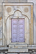 Lavender colored door, Taj Mahal, a mausoleum located in Agra, India, built by Mughal Emperor Shah Jahan in memory of his favorite wife, Mumtaz Mahal.
