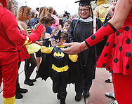 Anna S. Kuhl Elementary School students and teachers walk through rows of Port Jervis seniors in costume in front of the high school during the Halloween Parade, a tradition in Port Jervis for more than 30 years, on Thursday, Oct. 31, 2013. The parade starts with the seniors walking through hallways lined with elementary school students and ends with the elementary school students walking through a line of seniors.