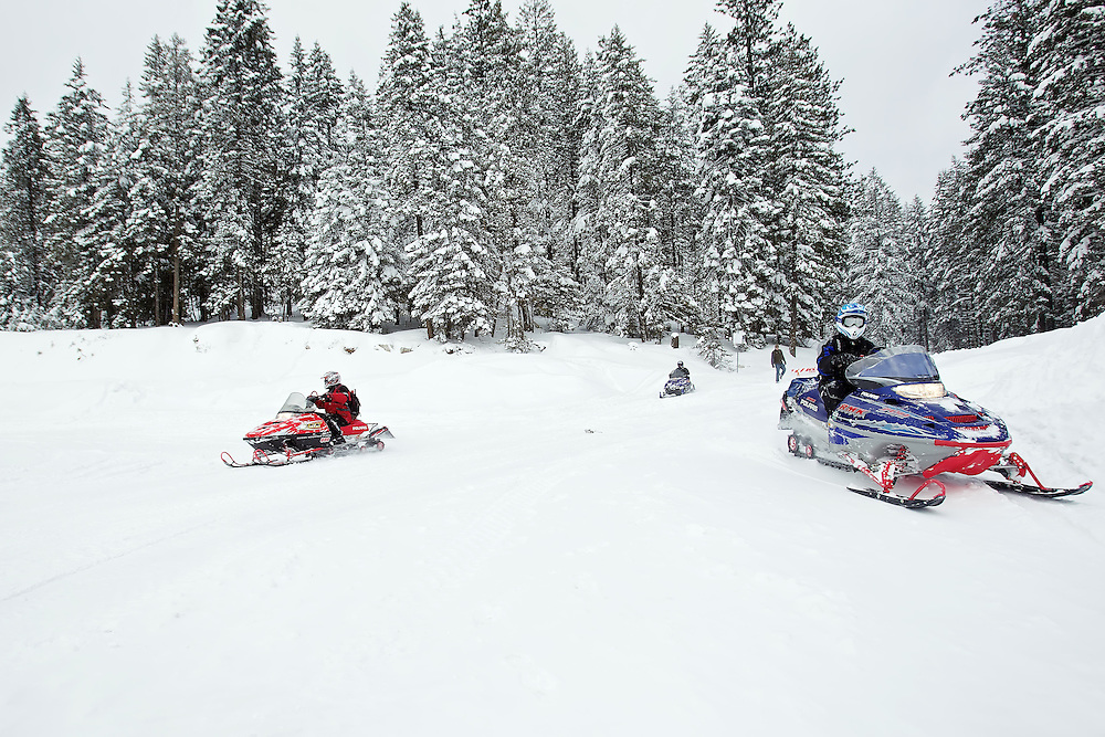 Snowmobilers return from a six-hour trail ride Friday on the Fernan Saddle where they experienced three and four-foot-deep snow drifts along the route.