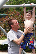 Christian Taylor of Dayton (left) and Eli, 4 at Orchardly Park in Oakwood, Sunday, June 9, 2013.