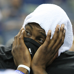 18 February 2009: Orlando Magic center Dwight Howard (12) with a towel covering his head and his shirt covering most of his face watches the final minutes from the bench during a 117-85 win by the New Orleans Hornets over the Orlando Magic at the New Orleans Arena in New Orleans, Louisiana.