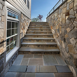 19595 Aberlour rear exterior landscaping stone exterior basement stairs