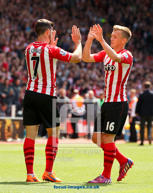 Shane Long (left) of Southampton celebrates scoring his sides fourth goal with his team mate James Ward-Prowse (right) during the Barclays Premier League match at the St Mary's Stadium, Southampton<br /> Picture by Tom Smith/Focus Images Ltd 07545141164<br /> 16/05/2015