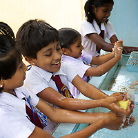 "Grade 4 Childrens Brigade students washing their hands in UNICEF-supplied sinks at the K.M. Vivekanana Vidalayam school in Kalmunai, Ampara Dist. <br /> <br /> The Kalmunai community was tsunami affected and for six months the school grounds became an IDP camp. The school continued teaching during this time in a local temple. The school is known as a ""Child Friendly School"". Unicef has provided sanitary facilities: boys and girls toilets and hand washing area. Immediately after the tsunami, Unicef supplied books to the school. Unicef has trained teachers in child friendly education and in the establishment of a Children's Brigade. Children's Brigades are a means of promoting hygiene practice in pupils and encouraging them to disseminate messages of hygiene practice and awareness in the wider community.<br /> <br /> Photo: Tom Pietrasik<br /> Ampara District, Sri Lanka<br /> September 29th 2009"