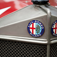 MILAN, ITALY - JUNE 23: Alfa Romeo logos are displayed on a 1924 RL Targa Florio at an Alfa Romeo exhibition on June 23, 2010 in Milan. Italian car manufacturer Alfa Romeo celebrates its 100th anniversary as the original company A.L.F.A was founded in Milan on June 24, 1910...***Agreed Fee's Apply To All Image Use***.Marco Secchi /Xianpix. tel +44 (0) 207 1939846. e-mail ms@msecchi.com .www.marcosecchi.com