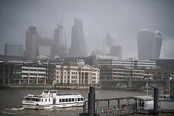 © Licensed to London News Pictures. 27/02/2018. London, UK. Snowfall over the skyline of the City of London, as a cold front, named the 'Beast From the East' hits the capital. Amber weather warnings are in place for large parts of the east of the UK as a severe cold front heads in from Russia. Photo credit: Ben Cawthra/LNP
