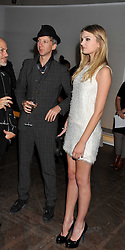JEFFERSON HACK and LILY DONALDSON at a dinner hosted by Calvin Klein Collection to celebrate the future Home of The Design Museum at The Commonwealth Institute, Kensington, London on 13th October 2011.