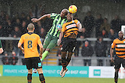 Tom Elliott of AFC Wimbledon and Andy Yiadom of Barnet FC clash for a high ball  during the Sky Bet League 2 match between Barnet and AFC Wimbledon at Underhill Stadium, London, England on 20 February 2016. Photo by Stuart Butcher.