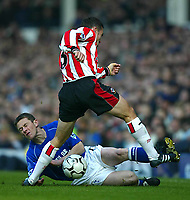 Photo. Aidan Ellis<br />Everton v Southampton. FA Barclaycard Premiership 22/02/03.<br />Everton Gary Naysmith and Southampton Paul Telfer<br />.