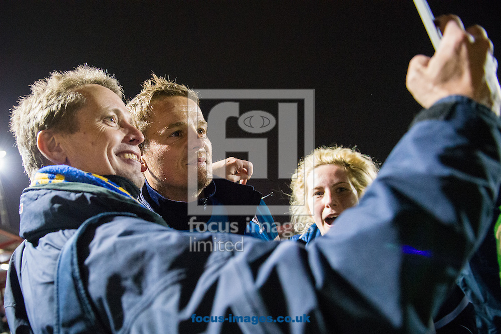 AFC Wimbledon manager Neal Ardley poses for a selfie with fans during a pitch invasion following victory in the Sky Bet League 2 Playoff Semi-final Leg Two at the Fraser Eagle Stadium, Accrington<br /> Picture by Matt Wilkinson/Focus Images Ltd 07814 960751<br /> 18/05/2016