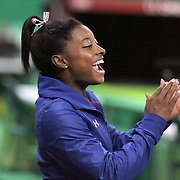 Gymnastics - Olympics: Day 10  Simone Biles #391 of the United States cheers on her team mate Lauren Hernandez #393 of the United States while performing her routine which won her the silver <br />  medal in the Women's Balance Beam Final during the Artistic Gymnastics competition at the Rio Olympic Arena on August 15, 2016 in Rio de Janeiro, Brazil. (Photo by Tim Clayton/Corbis via Getty Images)
