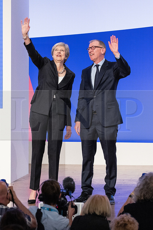 © Licensed to London News Pictures . 03/10/2018. Birmingham, UK. Prime Minister THERESA MAY and her husband PHILIP MAY leave the conference waving after the leaders' speech . Day 4 of the Conservative Party conference at the ICC in Birmingham . Photo credit: Joel Goodman/LNP