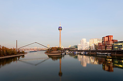 Evening view of modern property development at Media Harbour or Medienhafen in Dusseldorf Germany