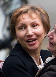 © Licensed to London News Pictures. 21/01/2016. London, UK. A smiling MARINA LITVINENKO  leaves the The High Court in London where a  report into the killing of  her husband, Alexander Litvinenko was released. Alexander Litvinenko was poisoned with the radioactive isotope polonium-210  in London. Photo credit: Ben Cawthra/LNP