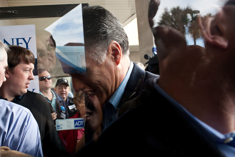 Republican presidential candidate Mitt Romney enters his campaign office after a campaign rally on Thursday, January 19, 2012 in Charleston, SC.