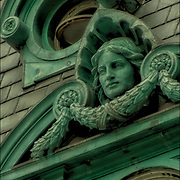 Decorative and ornamental stonework and sculptures on the  Surrogate Court building, in NYC. <br />