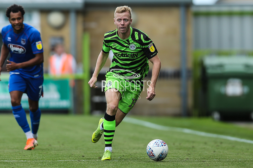 Forest Green Rovers Nathan McGinley(19) runs forward during the EFL Sky Bet League 2 match between Forest Green Rovers and Grimsby Town FC at the New Lawn, Forest Green, United Kingdom on 17 August 2019.