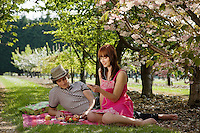 Couple Picnicking in Orchard