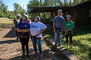 Students and parents watch people zipline on Sept. 30, 2018 at the Challenge Course at The Ridges. Photo by Hannah Ruhoff