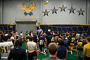 Head coach Joseph Gillespie speaks with his team after practice with reminders of the teams successful past above him at Stephenville High School in Stephenville, Texas on November 5, 2013. (Cooper Neill / for The New York Times)