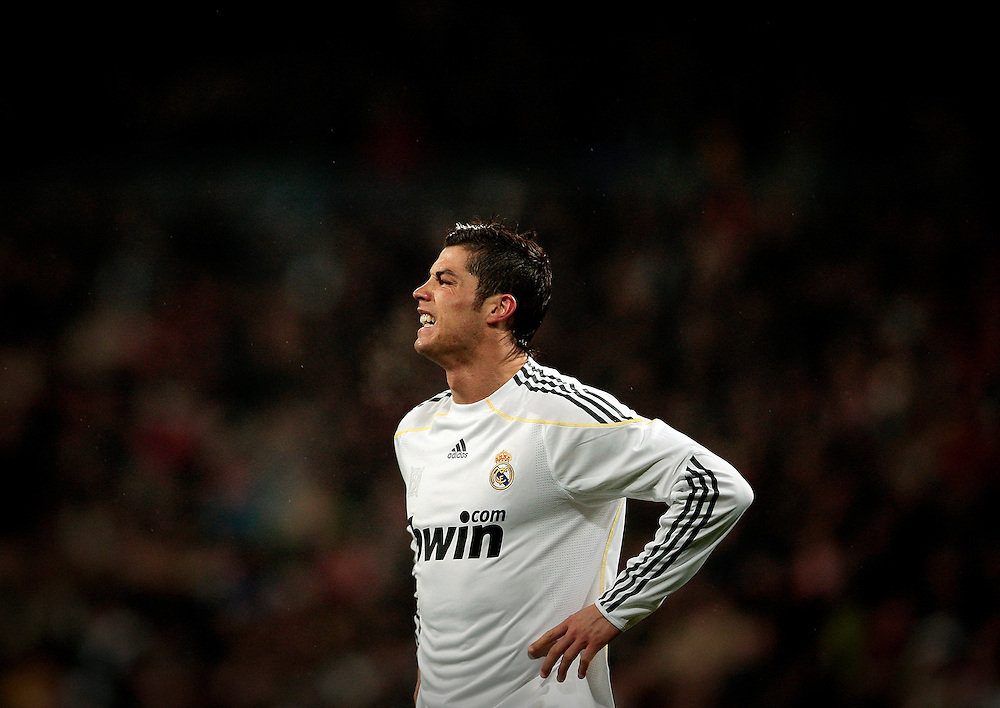 Real Madrid's Cristiano Ronaldo from Portugal, reacts during a Spanish La Liga soccer match against Sevilla at the Santiago Bernabeu stadium, Saturday, March 6, 2010.
