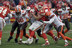 Dec 27, 2015; Kansas City, MO, USA; Kansas City Chiefs tight end Travis Kelce (87) catches a pass and is tackled by Cleveland Browns strong safety Donte Whitner (31) during the second half at Arrowhead Stadium. The Chiefs won 17-13. Mandatory Credit: Denny Medley-USA TODAY Sports