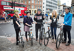 L-R - Cathy Hollingworth, wife of inventor of Brainy Bike Lights, Crawford, Mara Klein, keen cyclist, moved recently from Berlin to London and shocked at how little safety there is for cyclists.<br /> Crawford Hollingworth, inventor of Brainy Bike Lights, behavioural scientist and frightened cyclist.   Launched today priced at £45 per pair www.brainybikelights.com.<br /> Crawford created Brainy Bike Lights in an attempt to improve urban cycle safety, London, United Kingdom. Monday, 7th April 2014. Picture by Daniel Leal-Olivas / i-Images