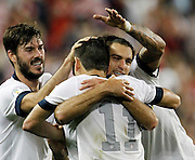 United States defender Brad Evans, left, midfielder Graham Zusi, center, and midfielder Alejandro Bedoya (11) celebrate a goal in the second half of a 2014 World Cup qualifier soccer match against Jamaica at Sporting Park in Kansas City, Kan., Friday, Oct. 11, 2013. Zusi scored the goal and Bedoya got the assist in the U.S. 2-0 win over Jamaica. (AP Photo/Colin E. Braley)