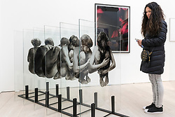 "© Licensed to London News Pictures. 17/05/2019. LONDON, UK. A woman views ""Exhibit"", 2015, by Lenny Rébéré at the Draw Art Fair London, the first fair in the UK dedicated to modern and contemporary drawing.  58 international galleries have juxtaposed drawings with related paintings, sculptures, photos or videos, in a ratio of approximately 70% to 30%, using drawing as the core concept.  The inaugural show is open to the public 17 to 19 May 2019 at the Saatchi Gallery in Chelsea.  Photo credit: Stephen Chung/LNP"